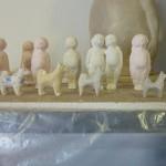 Line of babies and dogs from casts.